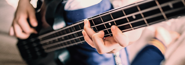 closeup of teenage girl playing bass