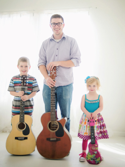 Cory Moon of Red Dirt Music Academy with his two children