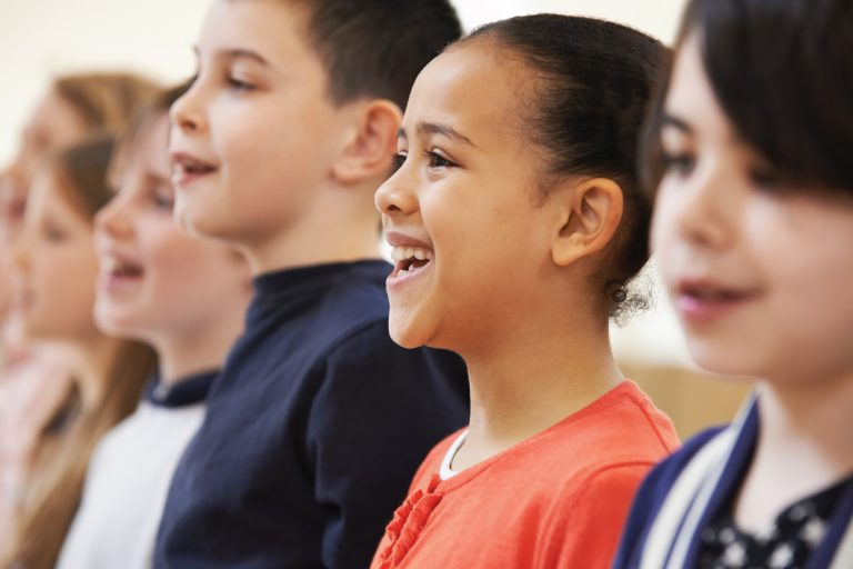 group of young students in group vocal lesson